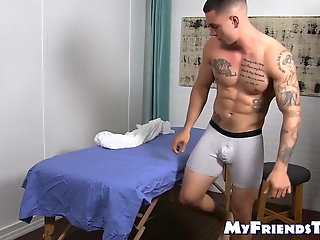 handsome tattooed jock massaged hunky gay