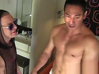 muscly japanese receives sensual handjob oil